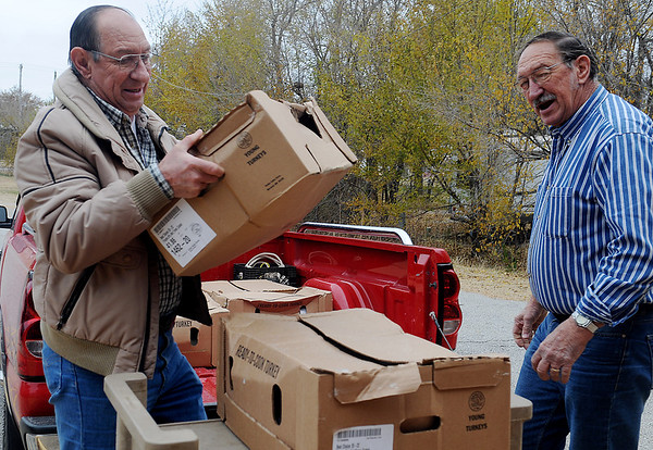 Leroy Patocka (left) and Al Patocka deliver 380 pounds of turkey to the Knights of Columbus Lodge 1044 on W. Willow Friday, Nov. 22, 2013. The National Wild Turkey Federation, Cherokee Strip Chapter donated 200 pounds of the meat for the Knights of Columbus Thanksgiving meal at St. Francis Xavier Catholic Church's Leven Center. The members prepare and serve the feast to more than 400 each year. (Staff Photo by BONNIE VCULEK)