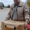 Leroy Patocka delivers turkeys to the Knights of Columbus Hall on W. Willow Friday, Nov. 22, 2013. (Staff Photo by BONNIE VCULEK)