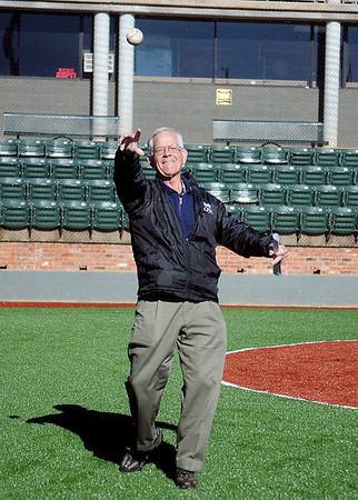 Paul Allen throws a baseball as he checks out the new artificial turf at David Allen Memorial Ballpark Wednesday, Nov. 27, 2013. Paul and Joan Allen, who had the facility built in 1999 in honor of their son, David, donated the additional funds to install the new infield and warning track at the ballpark. (Staff Photo by BONNIE VCULEK)