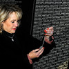 Oklahoma Gov. Mary Fallin reads the name, William Albert Pritchard, on a set of dog tags left at the Vietnam Memorial Wall replica during a tour of the new permanent memorial at Enid Regional Woodring Airport in Enid, Okla. Wednesday, Nov. 13, 2013. (Staff Photo by BONNIE VCULEK)