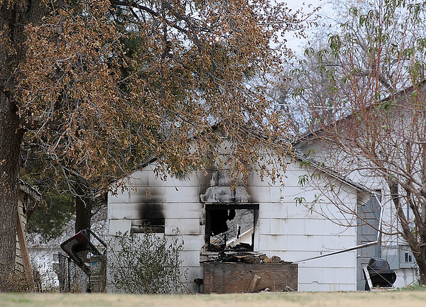 A photo taken from the 700 block of E. Park shows the back of a garage at 727 E. Oklahoma after a motorcycle backfired igniting fuel vapors. According to the Enid Fire Department and Enid Police Department who responded to the scene, no one was injured, but the garage and contents were a total loss. (Staff Photo by BONNIE VCULEK)
