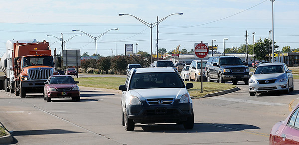 Traffic detours around a two-vehicle injury accident scene as Enid Police Department officers investigate the collision at the N. Van Buren and Mulberry intersection Friday, Nov. 1, 2013. One woman was transported to a nearby hospital by Life EMS while the Enid Fire Department and Enid Police Department remained at the scene. (Staff Photo by BONNIE VCULEK)
