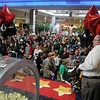 Shoppers fill the Oakwood Mall food court and aisles as J. Curtis Huckleberry calls out the first, gold ticket number during the 4th annual Black Friday Extravaganza cash give-away by 103.1 KOFM and 960 KGWA Radio. Winners during the Black Friday Extravaganza at Oakwood Mall include Kara Vogt and Keith Holsten, $250 each, Christie Nelson and Carol Ounnam, $500 each, Jan Schwerdtfeger and Shari Monsees, $1,000 each and April Foster, winner of the Carnival Cruise 7-day trip. (Staff Photo by BONNIE VCULEK)