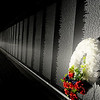 A memorial wreath appears near the apex of the Vietnam Memorial Wall replica at Enid Woodring Regional Airport's newest memorial site Wednesday, Nov. 13, 2013. (Staff Photo by BONNIE VCULEK)