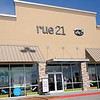 The grand opening of the 1,000th rue 21 store began with a ribbon cutting Thursday, Nov. 14, 2013. (Staff Photo by BONNIE VCULEK)