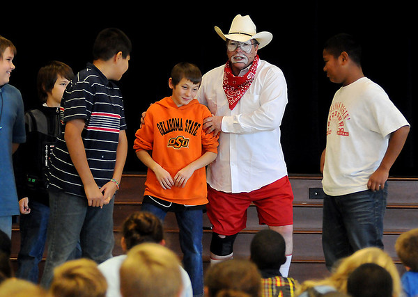 Marvin Nash, a PBR Bull Riding Rodeo Clown, enlists the help of Garfield Elementary School students during an anti-bullying skit Friday, Nov. 15, 2013. Nash's presentation encouraged all students to be kind to each other and stop any bullying that they might see. (Staff Photo by BONNIE VCULEK)