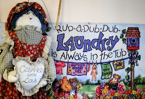 Laundry memorabilia decorates the interior of Oxford Cleaners Thursday, Nov. 21, 2013. The downtown business, owned by Karen Whitley, will close Nov. 29 after 75 years. Whitley has been working at Oxford Cleaners since 1976 and later purchased the building. (Staff Photo by BONNIE VCULEK)