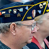 A vietnam veteran listen to speakers during a retirement and dedication ceremony for the Vietnam Memorial Wall Monday at Woodring Airport. (Staff Photo by BILLY HEFTON)