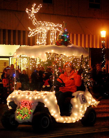 Diane Williams waves to the crowd during the first annual Christmas Lights Parade during Enid Lights Up the Plains in downtown Enid Friday, Nov. 29, 2013. (Staff Photo by BONNIE VCULEK)