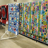 A woman examines the one of the hand-stitched quilts available at the 36th annual Oklahoma Mennonite Relief Sale Friday, Nov. 1, 2013. Craft and quilt auctions begin Saturday during the annual disaster relief fundraising event at the Chisholm Trail Expo Center. (Staff Photo by BONNIE VCULEK)
