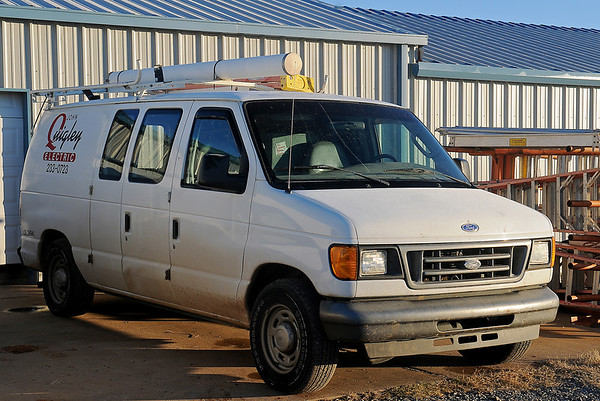 Rodger Griffin warms up one of his business vans for his employees Tuesday, Nov. 26, 2013. Griffin purchased John Quigley Electric six months ago and offers health insurance to his employees. (Staff Photo by BONNIE VCULEK)