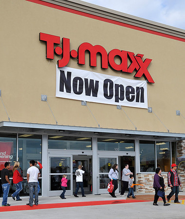 A steady flow of customers enter and exit the T.J. Maxx store at the Enid Crossing shopping center as the store opened for business Sunday. (Staff Photo by BILLY HEFTON)