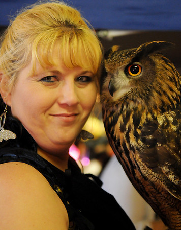 Tammy Lyne with Ritual, an Eurasian Eagle Owl, during Phoenix Quest at Leonardo's Children's Museum and Adventure Quest Saturday, Nov. 23, 2013. (Staff Photo by BONNIE VCULEK)