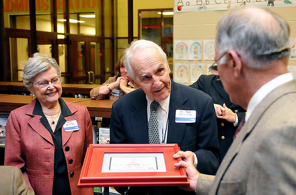 Stan Browlee presents Dr. Bob and Betty Shuttee with a certificate of gratitude from the United Way for their leadership donation to the Early Childhood Center fund drive during a program at Garfield Elementary Tuesday. (Staff Photo by BILLY HEFTON)