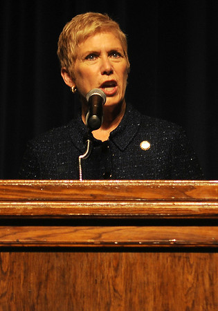 Oklahoma Superintendent of Public Instruction Dr. Janet Barresi addresses Enid High School students, faculty, guests and staff during the National Math and Science Initiative Award assembly Friday, Nov. 8, 2013. Enid High School, who has been recognized as a NMSI School, was presented with a check for $450,000. NMSI's generous sponsors and partners include AdvancePierre Foods, Dillingham Insurance, GEFCO and Oklahoma Department of Education. (Staff Photo by BONNIE VCULEK)