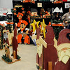 Customers view the hand-crafted items at a booth during the Home for the Holidays Home Show at the Chisholm Trail Expo Center Saturday, Nov. 23, 2013. (Staff Photo by BONNIE VCULEK)