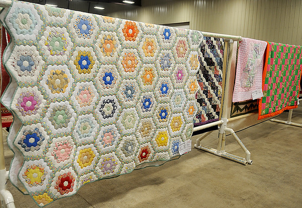 More than 100 handmade quilts will be available for purchase during the 36th annual Oklahoma Mennonite Relief Sale at the Chisholm Trail Expo Center Friday and Saturday, Nov. 1-2, 2013. (Staff Photo by BONNIE VCULEK)