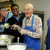 Rev. Rajesh K. Mankena (center) pauses for a portrait with the Knights of Columbus, Lodge 1044, as they serve the Thanksgiving Day dinner to more than 400 guests at St. Francis Xavier Catholic Church Leven Center Thursday, Nov. 28, 2013. (Staff Photo by BONNIE VCULEK)