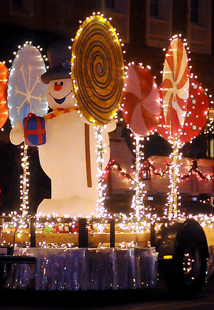 Sweet lollipops surround Frosty the Snowman on the Enid Junior Welfare League float during Enid Lights Up the Plains christmas lights parade in downtown Enid Friday, Nov. 29, 2013. (Staff Photo by BONNIE VCULEK)