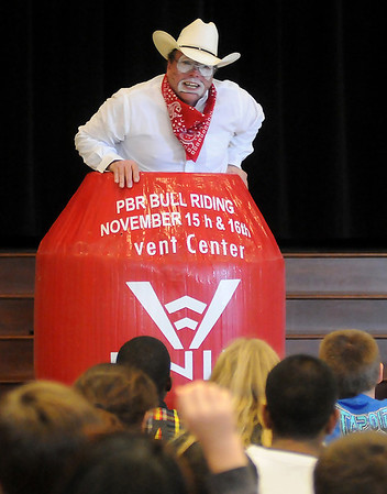 Marvin Nash climbs inside his PBR Bull Riding rodeo clown barrel during an anti-bullying presentation at Garfield Elementary School Friday, Nov. 15, 2013. (Staff Photo by BONNIE VCULEK)