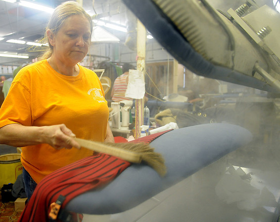 Tina Howery prepares a blouse for steam pressing at Oxford Cleaners Thursday, Nov. 21, 2013. The downtown Enid business, owned by Karen Whitley, will close on Nov. 29 after 75 years of operation. (Staff Photo by BONNIE VCULEK)