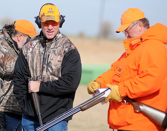 Wyoming Gov. Matt Mead (left) competes during the Grand National Quail Hunt at the Grand National Gun Club Thursday, Nov. 14, 2013. (Staff Photo by BONNIE VCULEK)
