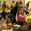 Volunteers assist guests during the annual Thanksgiving dinner at the First Baptist Church Thursday, Nov. 28, 2013. According to Sue Norrie, the chief cook for the project, more than 500 meals were served by the volunteers. (Staff Photo by BONNIE VCULEK)