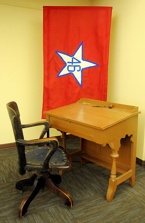 A new traveling exhibit at the Cherokee Strip Regional Heritage Center, an old Desk No. 11, used in the City Hall at Guthrie by A.H. Ellis, a Delegate from District 14, during the 1906-07 Oklahoma Constitutional Convention. It will be on display this Saturday only. (Staff Photo by BONNIE VCULEK)