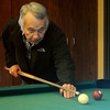 Delbert Boehm, supervisor of the Thelma J. Gungoll Youth and Family Services' shelter, plays pool with the youth that stay at the facility. The recreational time gives clients a chance to relax. Nights of Shelter, a fund-raising event for Youth and Family Services, provides the necessary support for the children that they assist each year. (Staff Photo by BONNIE VCULEK)