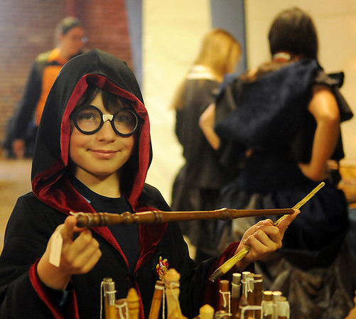 Cody Higbee, from Enid, shops for a perfect wand during Phoenix Quest at Leonardo's Children's Museum and Adventure Quest Saturday, Nov. 23, 2013. Hundreds of Harry Potter enthusiasts attended the two-day convention. (Staff Photo by BONNIE VCULEK)