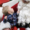Nolan Russell tugs on Santa's beard during Black Friday shopping at Oakwood Mall Friday, Nov. 29, 2013. Jolly Old St. Nick arrived at noon on an Enid Fire Department Engine 1. (Staff Photo by BONNIE VCULEK)