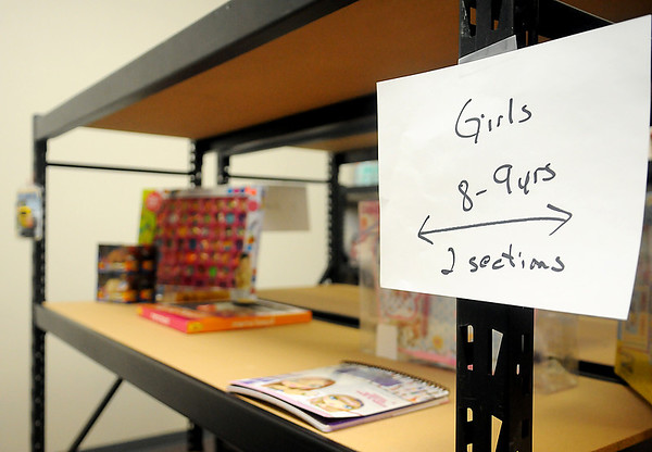 Only a few gifts for girls, ages 8-9 appear on the shelves at the Marine Corps Reserve Toys for Tots office on S. Independence. Thousands of gifts for infants thru age 18 are needed during the Christmas season. (Staff Photo by BONNIE VCULEK)