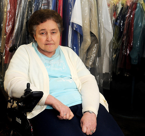 Karen Whitley, the owner of Oxford Cleaners, will close her business Nov. 29, 2013. Whitley began working at Oxford Cleaners in 1976 and later purchased it. The downtown Enid business has been open for 75 years. (Staff Photo by BONNIE VCULEK)