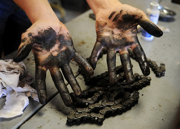 Jake Traynor's hands show how dirty motorcycle repair can be Saturday, Nov. 30, 2013. Traynor, 14, spent the afternoon changing the oil and completing other maintenance on his 250 cc Virago. (Staff Photo by BONNIE VCULEK)