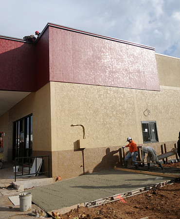 Rick Lorenz Construction workers smooth concrete for the west drive-thru at the new Pizza Hut in Broadway Plaza Thursday, Nov. 14, 2013. The Enid business will open as soon as renovations are complete. (Staff Photo by BONNIE VCULEK)