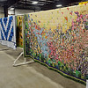 "An 111"" x 111"" multi-colored old fashion flower garden hand stitched quilt, designed and pieced by Verna Regier, and quilted by Friendship Quilters at Grace Mennonite Church is one of the many quilts that will be auctioned during the 36th annual Oklahoma Mennonite Relief Sale at the Chisholm Trail Expo Center Friday-Saturday, Nov. 1-2, 2013. (Staff Photo by BONNIE VCULEK)"