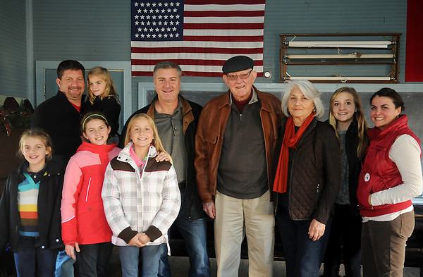 The Gigoux family pauses for a portrait inside the Turkey Creek School at Humphrey Heritage Village Tuesday, Nov. 26, 2013. Family members (from left) Elena, Gerald, Bella, Ainsley, Juliette, Jeffrey, Jim, Mary Jane, Avery and Victoria Gigoux spent the day visiting several locations important to the Gigoux heritage. (Staff Photo by BONNIE VCULEK)