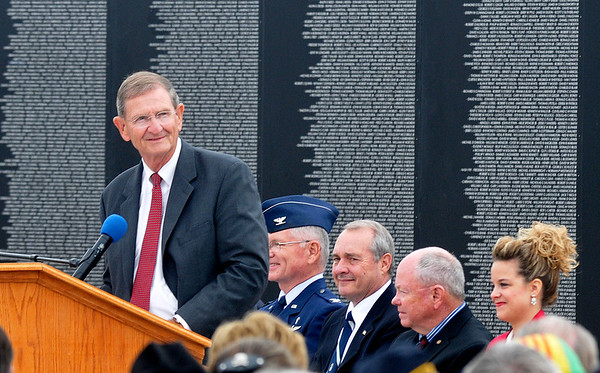 Enid mayor Bill Shewey talks during the retirement and dedication ceremony for the Vietnam Memorial Wall Monday at Woodring Airport. (Staff Photo by BILLY HEFTON)