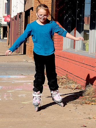 Erin Traynor tries out her new roller blades Saturday, Nov. 30, 2013. (Staff Photo by BONNIE VCULEK)