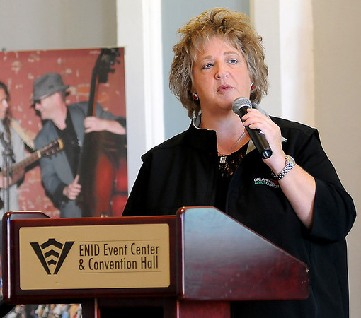 Lori Coats, with Oklahoma Tourism Department, discusses why individuals are visiting farms and ranches during the Red Carpet Tourism Conference in the Lt. Nick Benson Memorial Ballroom at the Enid Event Center and Convention Hall Tuesday, Nov. 12, 2013. (Staff Photo by BONNIE VCULEK)
