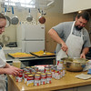 Erin Norrie and William Ostermaier prepare cornbread dressing Wednesday, Nov. 27, 2013, for the annual Thanksgiving dinner at the First Baptist Church. The meal will be served at the church from 11 a.m. - 1 p.m. and individuals and families may pick up a to-go-meal. (Staff Photo by BONNIE VCULEK)