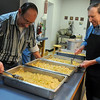 Leroy Patocka and Bob Maly (from left) prepare cornbread dressing for the annual Knights of Columbus Thanksgiving dinner from 11 a.m.-1 p.m. at St. Francis Xavier Catholic Church Leven Center Thursday, Nov. 28, 2013. Individuals or families that do not have transportation to the church may call (580) 234-6882 for meal delivery. (Staff Photo by BONNIE VCULEK)