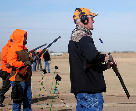 Wyoming Gov. Matt Mead (right) ejects a shell casing from his gun as he competes during the Grand National Quail Hunt at the Grand National Gun Club Thursday, Nov. 14, 2013. (Staff Photo by BONNIE VCULEK)