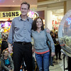 Alan Clepper, with KOFM, congratulates April Foster for winning the 7-day Carnival Cruise during the Black Friday Extravaganza drawing at Oakwood Mall Friday, Nov. 29, 2013. Winners during the Black Friday Extravaganza at Oakwood Mall include Kara Vogt and Keith Holsten, $250 each, Christie Nelson and Carol Ounnam, $500 each, Jan Schwerdtfeger and Shari Monsees, $1,000 each and April Foster, winner of the Carnival Cruise 7-day trip. (Staff Photo by BONNIE VCULEK)
