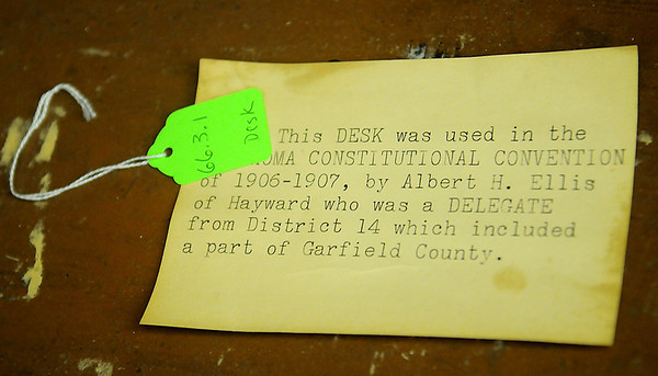 Old Desk Label placed inside the desk that was used during the Oklahoma Constitutional Convention of 1906-07 by Albert H. Ellis of Hayward who was a Delegate from District 14 which included a part of Garfield County.(Staff Photo by BONNIE VCULEK)