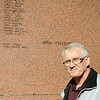 Ken Parker pauses near the back of the Veterans of Foreign Wars Memorial at Government Springs Park Thursday, Nov. 7, 2013, after the name of Lester Veazey, his half-brother, was etched into the Viet-Nam section. Veazey was critically wounded during the attack on Hill 881, and died at the age of 29 in 1977. The memorial, sponsored by the Veterans of Foreign Wars Lodge No. 2270 in Enid,  honors all Garfield County residents who were wounded or killed in the line of duty since World War I. (Staff Photo by BONNIE VCULEK)