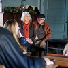 Jim Gigoux (right center) and his wife, Mary Jane, share a story about their family heritage as they visit the one room, Turkey Creek School at Humphrey Heritage Village Tuesday, Nov. 26, 2013. The Gigoux family toured the village and the Cherokee Strip Regional Heritgage Center to see their ancestors covered wagon donated to the museum in 1977 and located their personalized family bricks on row 40 near the 1905 Glidewell House. Jeffery Gigoux, his daughters, Avery and Juliette from California, Gerald and Victoria Gigoux and their daughters, Bella, Elena and Ainsley from Colorado accompanied Mary Jane and Jim during the day-long trip to the Gigoux homestead, the church in Carrier, and the museum. (Staff Photo by BONNIE VCULEK)