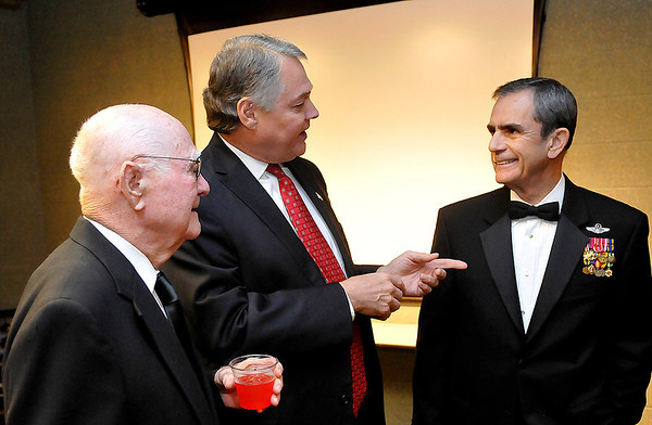 Legacy honoree, Coot Nelson (left) and David Henneke visit with keynote speaker, Colonel Lee Ellis, during a reception prior to the Legacy Award Ceremony Sunday at the Chisholm Trail Expo Center. (Staff Photo by BILLY HEFTON)