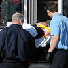 A woman is loaded into a Life EMS ambulance at the scene of a two-vehicle injury accident at the intersection of Mulberry and N. Van Buren Friday, Nov. 1, 2013. (Staff Photo by BONNIE VCULEK)