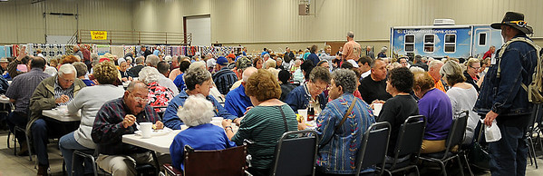 Guests enjoy a pork loin dinner, brats, homemade saurkraut, bierocks and pie during the opening night of the 36th annual Oklahoma Mennonite Relief Sale at the Chisholm Trail Expo Center Friday, Nov. 1, 2013. (Staff Photo by BONNIE VCULEK)
